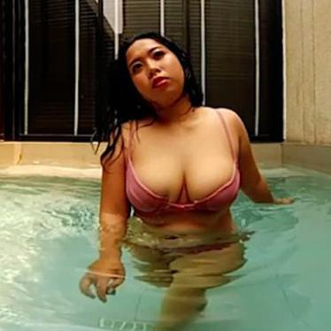 Chubby Asian with big tits teases you from the pool